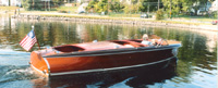 23 ft Chris Craft Custom Runabout Barrel Back in Water
